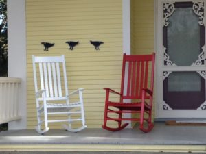 pair: red and white garden rocking chairs