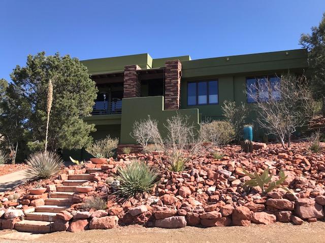 Earth tone home and red rocks Sedona, AZ