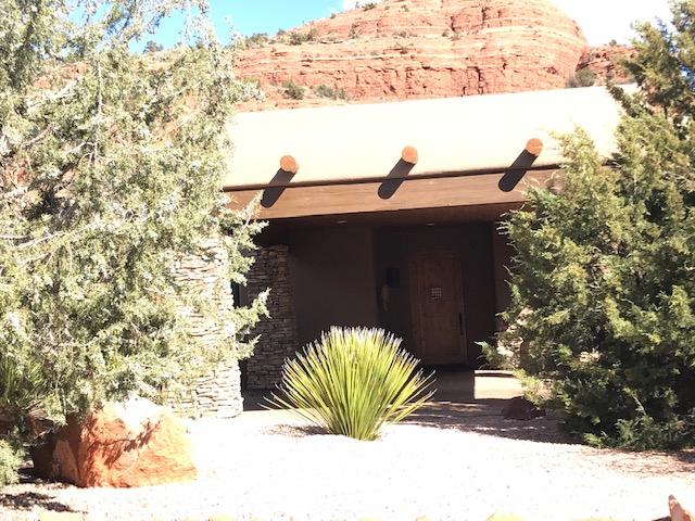 Yucca, pinyon pine and juniper front xeroscape garden, Sedona, AZ