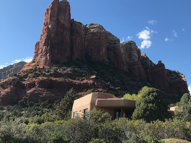 Sedona stucco home with beautiful red rock backdrop